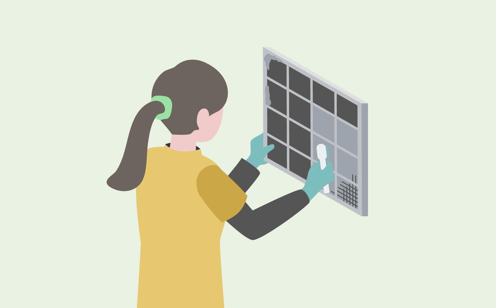 作業員の方が汚れた空調機フィルターを掃除しているイメージ