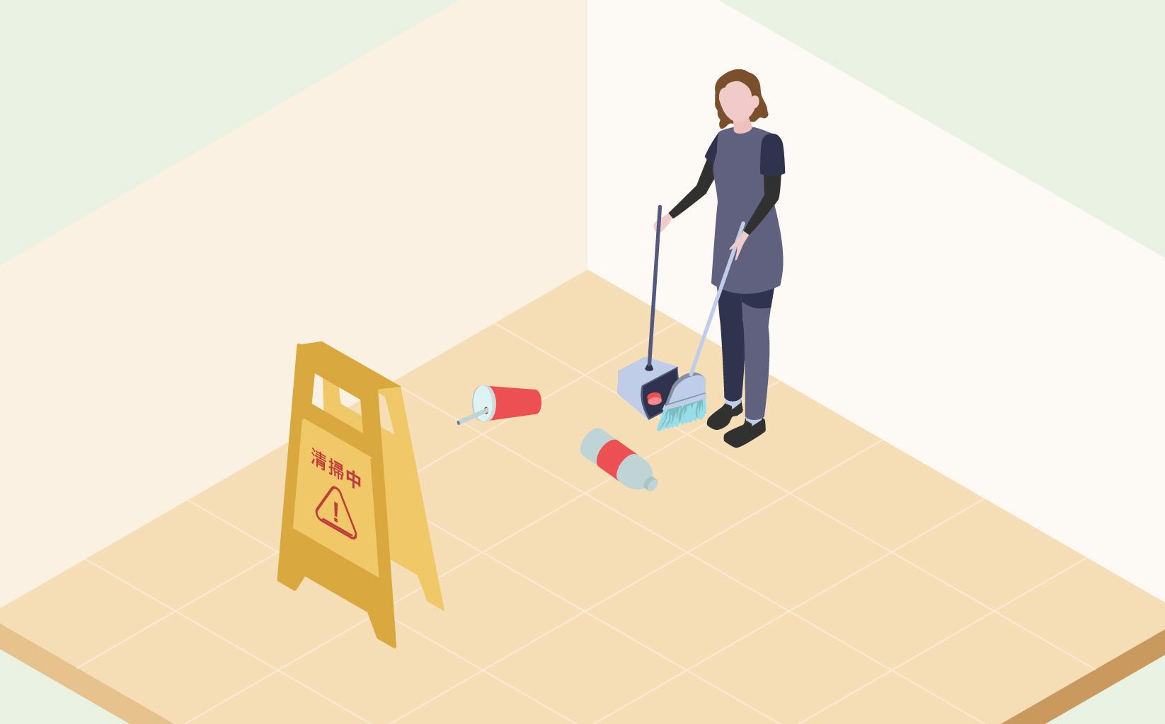 ゴミが落ちている床を従業員の方が清掃しており、清掃している場所に清掃中という立ち入り禁止の看板が設置されている